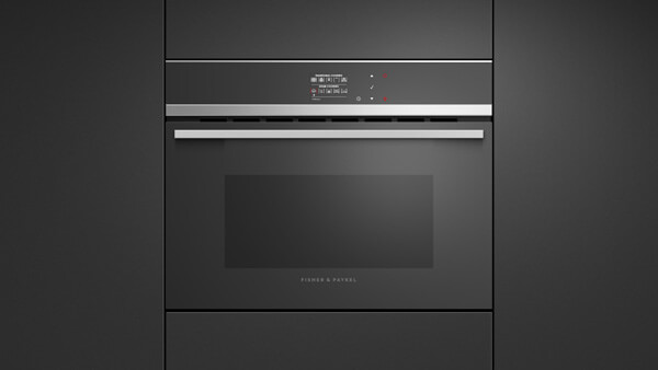 Built-in Convection and Steam Combo Oven Integrated Set into Black Cabinetry.
