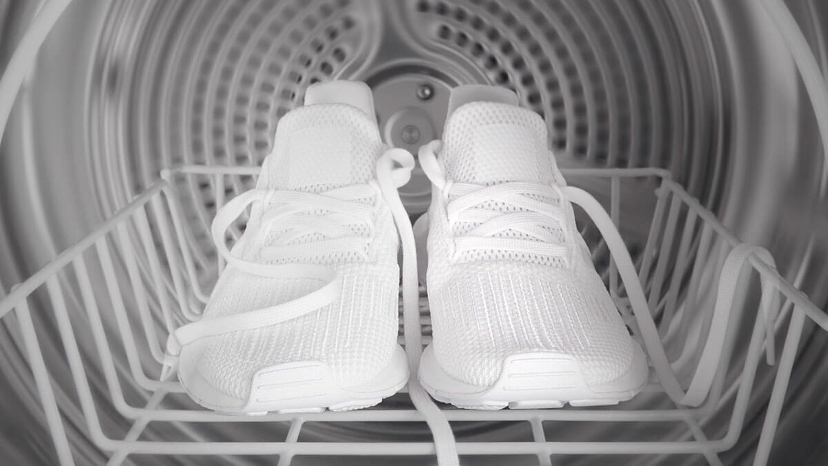 Interior of a Dryer with Pristine White Sneakers atop a Drying Rack.
