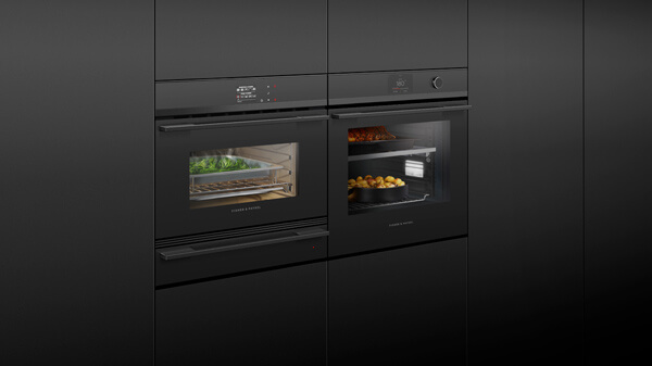 Combination of a Conventional and Steam Oven in Black with Silver Detailing Set into Black Cabinetry.