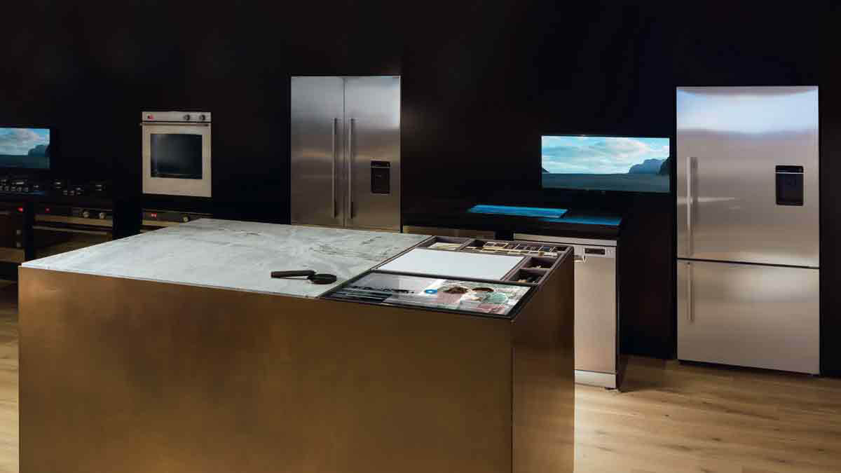 Lineup of Fisher & Paykel Ovens and Refrigerators close to a Marble Table at the Sydney Experience Centre.