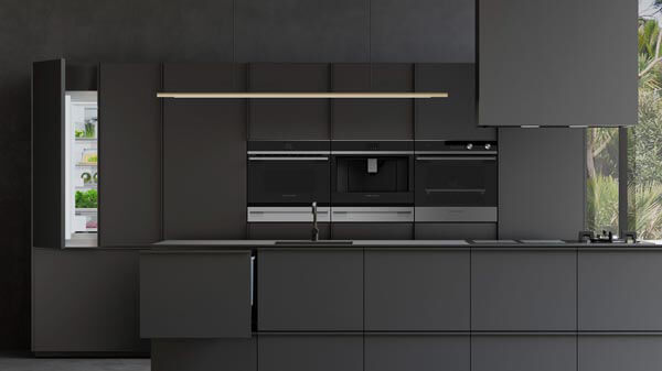 Black Cabinetry and Integrated Appliances in a Modern Kitchen.