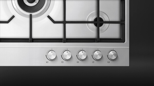 Top View of a Stainless Steel Contemporary Style Gas Cooktop.